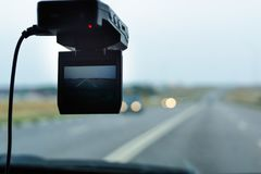 Front camera car recorder. Car DVR on the windshield. Front camera car recorder. Car DVR Royalty Free Stock Photography