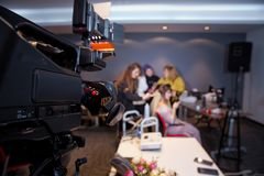 Makeup cosmetic at home. Focus on tripod mounted Video camera screen showing . In front of the camera to recording vlog video live stock photography