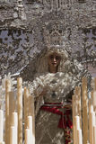 Front with candles, embroidered fabric and flowers of the throne of the Nuestra Señora de la Paz Royalty Free Stock Image