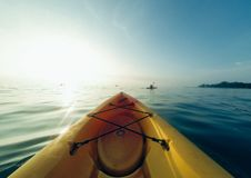 Front of a canoe sailing on lake Royalty Free Stock Image