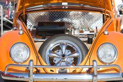 Front of Car. Orange beetle with retro styling paint job Stock Photo