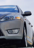 Front of car. Front of a sport car: bumper, headlight, floodlight Stock Image