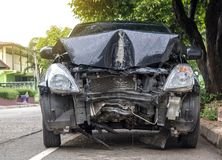 Front of car demolished from collision with electric pole. Royalty Free Stock Images