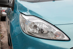 Front Car Light. Front Light of Turquoise Car Stock Photo