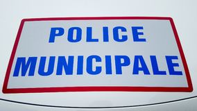 Front car from police municipale means municipal police in french. Sticker on car from police municipale means municipal police in french Royalty Free Stock Image
