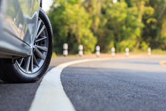 Front car wheel on the asphalt road royalty free stock photo