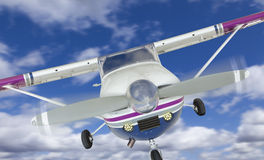 Front of Cessna 172 Single Propeller Airplane In The Sky stock image
