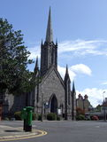 Front of Church in Rathmines, Dublin Ireland. View of Church front entrance on Church Avenue, Rathmines, Dublin Ireland, with  shrubs, trees & green postbox on Stock Photography