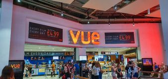 SHEFFIELD, UK - 29TH JUNE 2019: Customers line up to buy tickets for Toy Story 4 from Vue in Meadowhall, Sheffield, UK. The front of the cinema with groups of stock photography