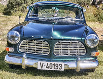 Front of the classic car in dark green stock photography