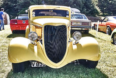 Front of the classic car in yellow stock photo