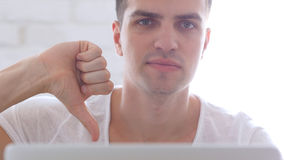 Front Close-Up of Man Thumbs Down. High quality Royalty Free Stock Images
