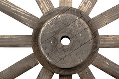 Front closeup view of weathered vintage wooden wagon wheel Stock Photos