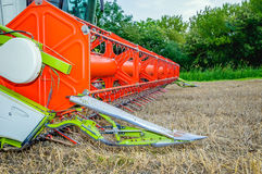Front of a colorful combine parked after finishing the work Stock Images