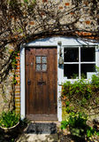 Front Cottage door. In cottage village stock photos