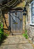 Front Cottage door. In cottage village royalty free stock photo