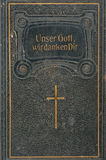 Front cover of leather-bound German song-book. Leather cover of an old German song-book,  leather-bound with golden rim, title says Our God we thank Thee Stock Image