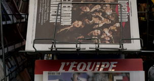 Front covers at press kiosk of French and International newspapers stock video footage