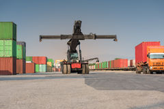 Front cranes or forklift working with container Stock Photo