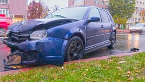 Front crashed car. Car accident on rainy road surface in city traffic Stock Photography