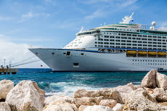 Front of Cruise Ship Moored Beyond Rock Seawall Royalty Free Stock Image