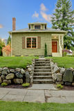 Front of the cute small green house. Royalty Free Stock Photo