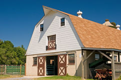 Front of dairy barn. A view of a classic country barn on a small dairy farm.  Gambrel style barn Stock Photography