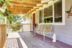 Front deck with antique bench Royalty Free Stock Images