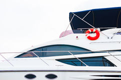 Front deck of the yachts with red lifebuoy Stock Images
