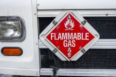 Flammable gas sign on the front of white shipping truck royalty free stock images
