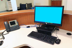 Front Desk. Counter with computer terminal and phone Stock Photo