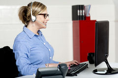 Front Desk Lady Busy Working Royalty Free Stock Photography