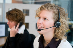 Front desk workers Stock Images