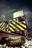 Front detail of old locomotive on background of storm clouds Stock Images