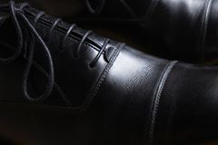 Front detail of a pair of black leather classic shoes Royalty Free Stock Image