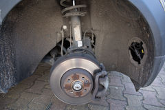 Front disc brake on car in process. Of new tire replacement stock photography
