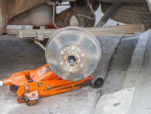 Front disc brake on car in process of new tire replacement Royalty Free Stock Photos