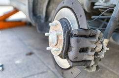 Front disk brake after rebuild surface on car, close up Stock Images