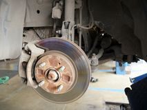 Front disk brake system of the car after remove the tire for repair and maintenance at car service center. Change Brake Pads Stock Photos