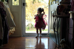 Front Door. Young girl looking out of front door Royalty Free Stock Images