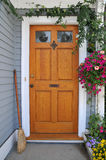 Front Door. Way adorned with flowers and greenery and swept clean welcomes visitors stock images