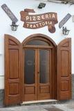 Front door. Wooden front door with shutters Royalty Free Stock Photography