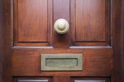Front door. Close-up of Brown front door stock photography