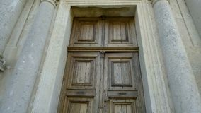 The front door of an ancient church stock video