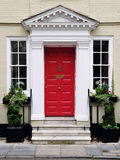 Front Door of a Beautiful House. Red Front Door of an Attractive Georgian Era Town House in London England Royalty Free Stock Photos
