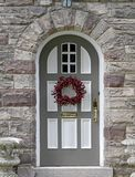 Front door. With berry wreath for Christmas Royalty Free Stock Images
