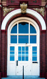 Front door brick building with arched windows doors with glass Royalty Free Stock Photos