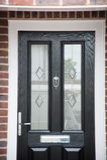 Front door on brick home Royalty Free Stock Photo