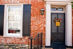 Front Door of Brick House. Main entrance and door to an old brick house in a small, rural community Stock Photo