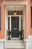 Front door, brick walls stock image